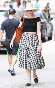 Anne Hathaway looked adorable in a black off-the-shoulder crop-top by Michael Kors while out and about in New York City.