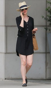 Anne Hathaway took a stroll in New York City wearing a breezy black shirtdress.