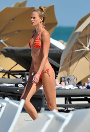 Anne showed off her bright orange bikini while hitting Miami beach.