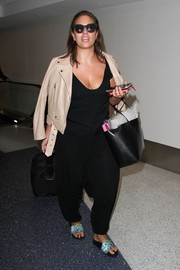 Ashley Graham completed her relaxed look with a pair of printed slides.
