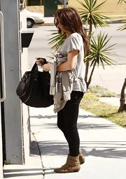 Ashley sported a flat pair of tan, multi-buckled ankle boots with a casual ensemble.