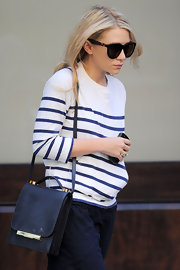 Ashley Olsen kept her cool in the streets of NYC in a pair of Acetate Croc Curved Oversized Cateyes.