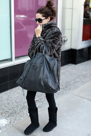 Ashley Tisdale hit the gym with a gray leather Giant Weekender bag in tow.