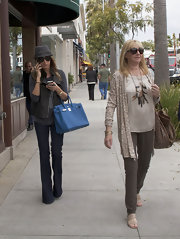 "Ashley Tisdale was out shopping in a pair of ""Kiki"" high-rise wide leg jeans."