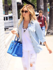 Chambray has never looked cooler than when Ashley Tisdale wore this top with torn white jeans and a vibrant Birkin bag.