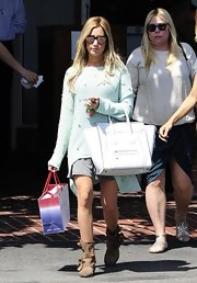 Ashley sported an oversize slouchy sweater in mint green while out shopping.