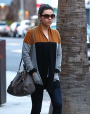 For her arm candy, Mila Kunis chose a brown leather shoulder bag by Miu Miu.