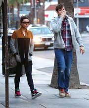 Mila Kunis took a stroll wearing a pair of colorful basketball sneakers by Nike.