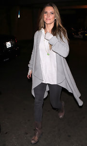 Audrina Patridge headed to LAX in distressed brown leather boots.