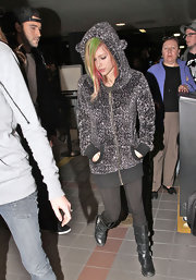 Avril showed her fuzzy side in a soft leopard zip-up with a playful hood at the airport.