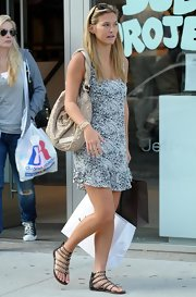 "Bar Refaeli looked summer ready in her gladiator sandals and floral frock. She topped her look off with a beige ""Olypme"" tote, which cost upwards of $2,000."