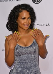 Christina Milian showed off her yellow mani during Beautycon LA 2016.