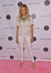 Ashley Tisdale kept it laid-back in a loose T-shirt by Free People teamed with white skinny jeans during Beautycon LA 2016.
