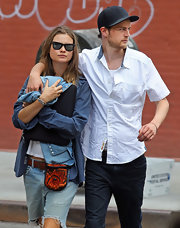 Behati Prinsloo was dressed down for lunch in baggy cutoffs, a button-down, and wayfarers.