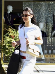 Bella Hadid was spotted out in Beverly Hills wearing cool cateye sunglasses and a gorgeous smile!