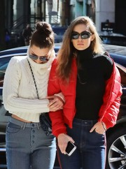 Gigi Hadid took a stroll in New York City wearing a pair of rectangular shades by Elizabeth and James.