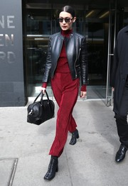 Bella Hadid pulled her outfit together with a pair of of black lace-up boots by Versus Versace.