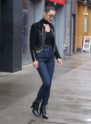 Bella Hadid was Western-chic up top in a black suede and leather jacket, also by Alexander Wang.