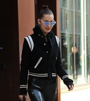 Bella Hadid was spotted out in New York City looking futuristic-chic in her Le Specs x Adam Selman sunglasses.