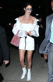 Bella Hadid offset a sexy white tube top with an oversized denim jacket by Alyx for a night out in New York City.