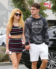 Bella Thorne went shopping wearing a chic pair of butterfly sunglasses.