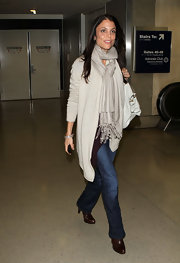 Bethenny Frankel made her way through LAX in brown leather ankle boots.