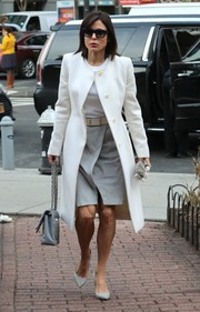 Underneath her coat, Bethenny Frankel wore a two-tone dress with a front-split skirt.