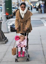 Bethenny Frankel took a stroll with daughter Bryn in still with this wool coat with belt.