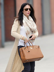 Bethanny Frankel wore this neutral striped scarf while out in NYC.