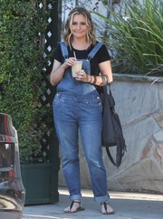 Beverley Mitchell topped off her ensemble with a tasseled gray tote.