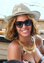 Beyonce Knowles completed her beach ensemble with a straw hat.