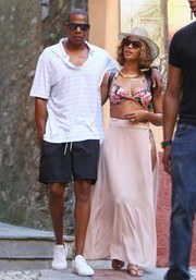 Beyonce Knowles completed her ensemble with a long pink cover-up.