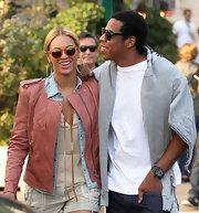 Beyonce Knowles visited Paris in round amber Illesteva sunglasses.