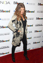 Fergie wear a black and white print evening coat over her dark ensemble.