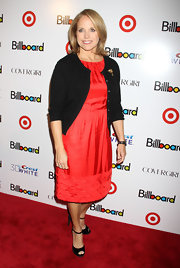 Katie Couric wore a red dress with a black cardigan for the Billboard Women in Music event.