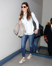 Jessica Biel teamed nude Soludos sneakers with skinny jeans and a denim shirt for a flight out of LAX.
