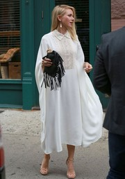 Naomi Watts turned heads on the streets of NYC in a collared white Valentino caftan featuring an intricately embroidered bodice.