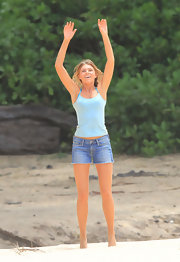 Indiana Evans' denim cutoffs and aqua camisole were just perfect for lounging at the beach.