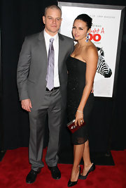 Luciana Damon accessorized her sleek black tube dress with a silver box clutch and stunning drop earrings.