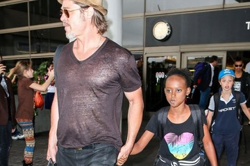 Brad Pitt Zahara Jolie Pitt Brad Pitt and Angelina Jolie Arrive on a Flight at LAX With Their Kids