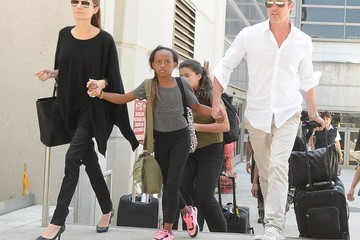 Brad Pitt Zahara Jolie Pitt The Jolie-Pitt Family Arriving On A Flight At LAX