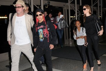Brad Pitt Zahara Jolie Pitt Brad Pitt & Angelina Jolie Catch A Flight Out Of LAX Airport