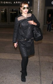 Suki Waterhouse traveled in edgy style wearing this black J Brand leather coat.