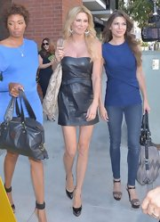 Brandi's strapless black leather mini dress showed off her long legs and bare shoulders.