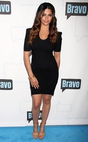 Camila Alves accessorized her sleek LBD with stacked gold bangles.