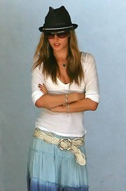 Bridgette Wilson paired a white v-neck sweater with a long skirt for a boho-chic look.