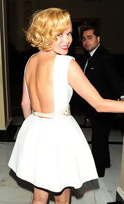 Amanda Holden stepped out on the town in London in a backless white mini dress.