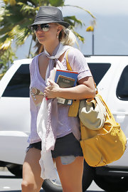 Britney's straw fedora was a summery, yet styled, way to quickly throw her hair up without looking unkempt.