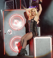 Britney is a dazzling diva in a fringed bodysuit with fishnet stockings on stage at the Jimmy Kimmel Show.