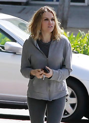 Brooke Mueller kept things basic in a simple gray hoodie and matching striped T-shirt.